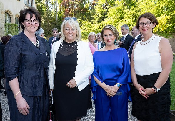 Duke Henri, Maria Teresa, Prince Guillaume and Princess Stephanie at a reception. Maria Teresa wore blue dress, Stephanie wore Prada floral dress