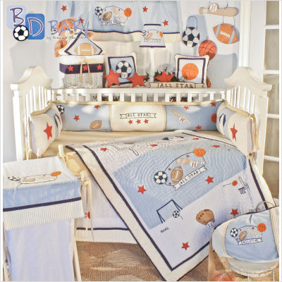 Here Is Light Colored Sports Bedding With Blue And White Pops Of Orange This Nursery Has Matching Hampers Pillows Lamp Shadeuch