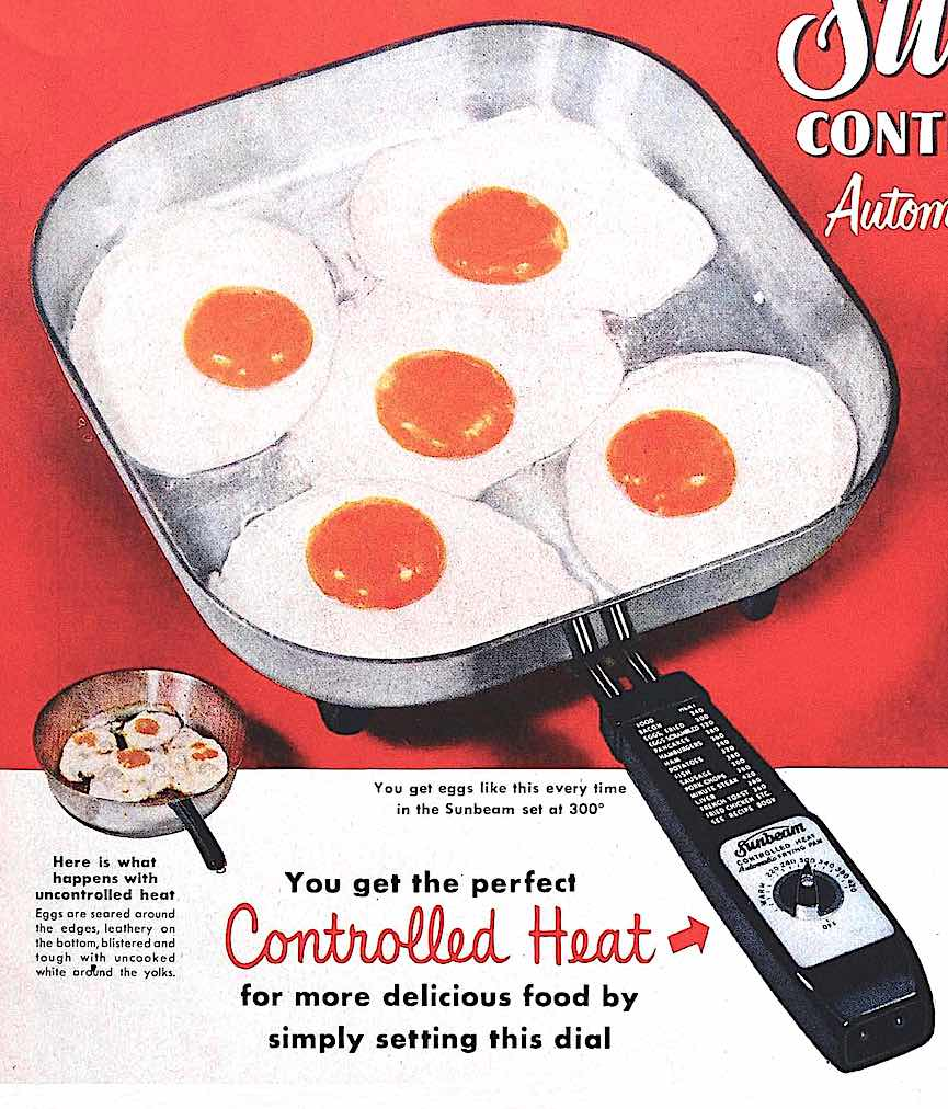 Five fried eggs in a 1960s Sunbeam electric pan, not showing the included glass cover
