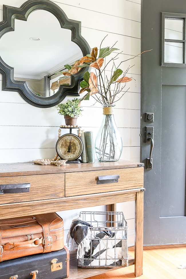 Decorate entryway with black vintage scale