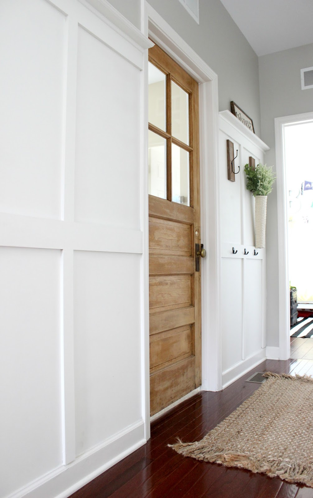 Delightfully Noted Home Tour - Vintage Salvage Wood Door Laundry Room Entry - Board and Batten Wall Treatment - Modern Farmhouse Decorating Ideas