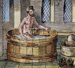 16th-century illustration of Archimedes in the bath, with Hiero's crown at bottom right