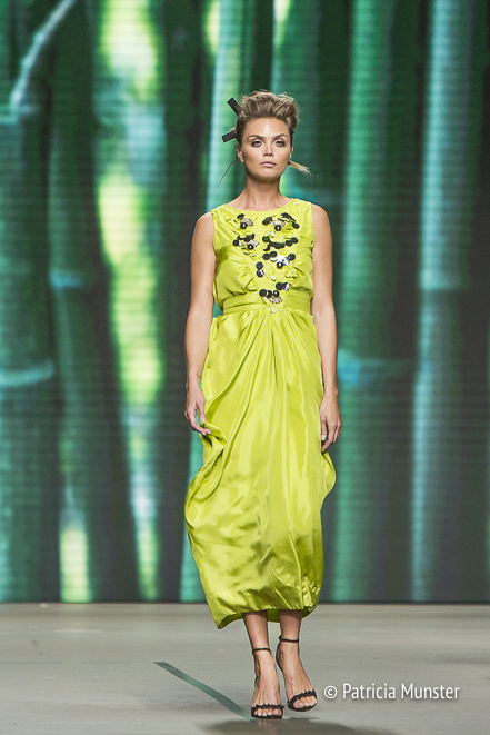 Kim Feenstra in a lime green dress with sequins at Amsterdam Fashion Week for Tony Cohen