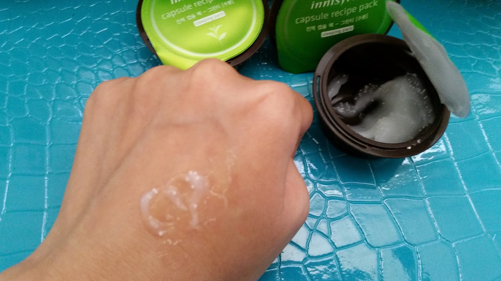 Green Tea Sleeping Pack spread on the back of hand