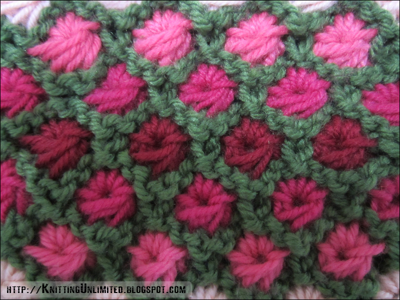 Aster flower knitting stitch is created in an unusual way to make flowers within a garter stitch border.