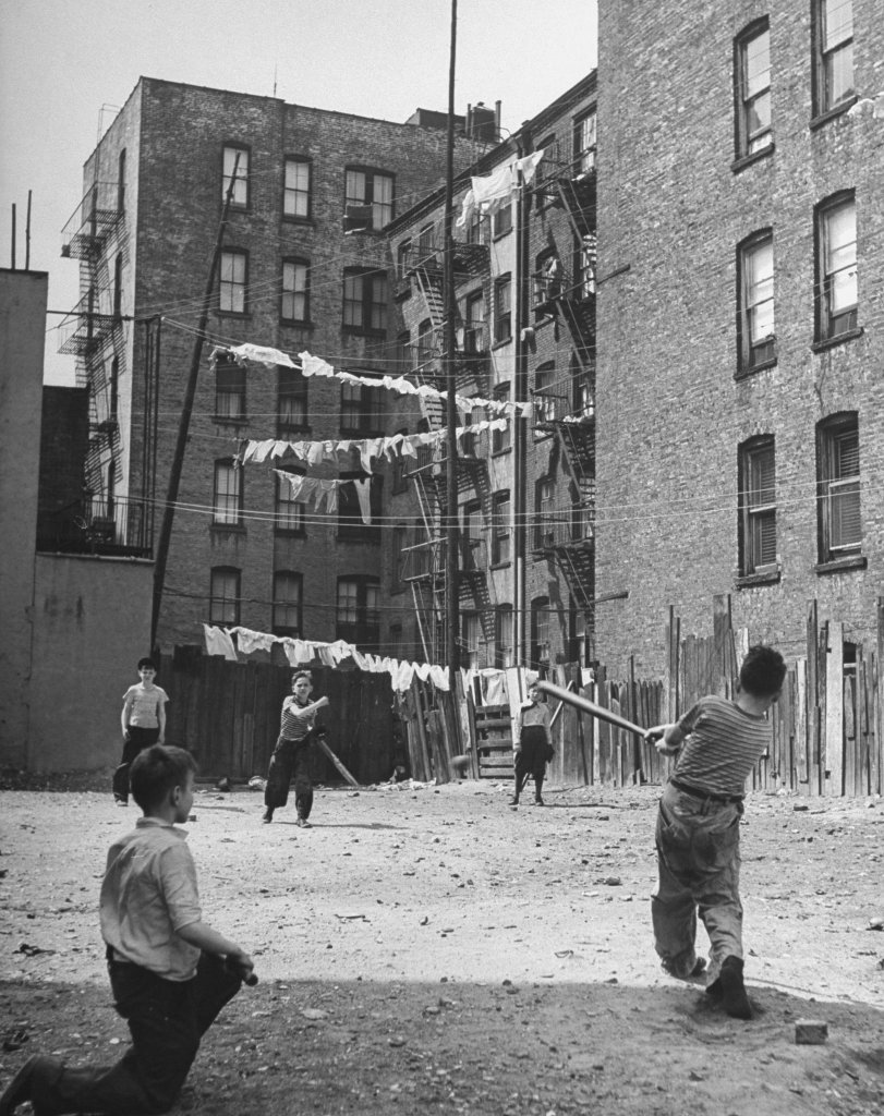 Boys playing stickball in a New York tenement lot. c1940