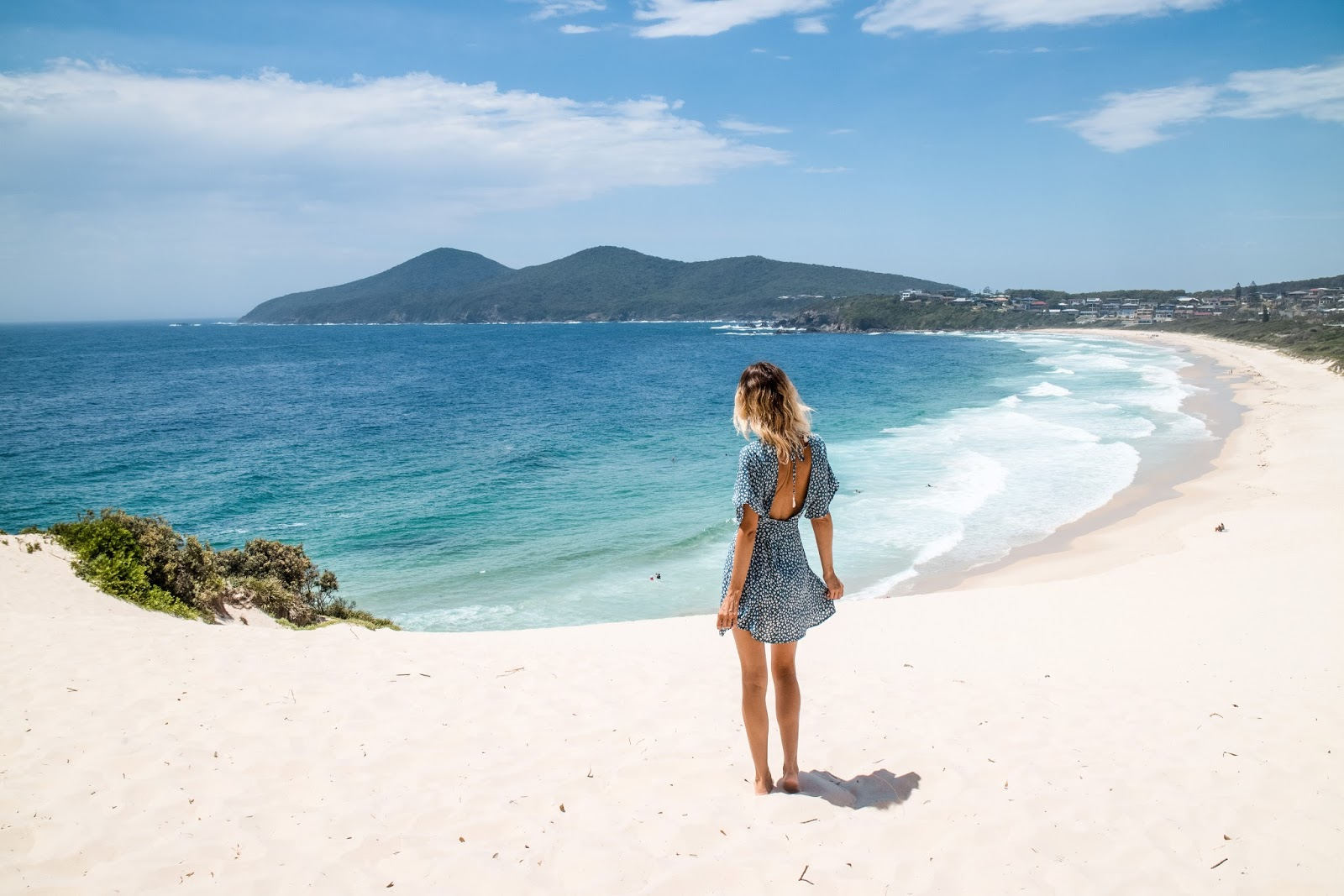 Travel Blogger, Alison Hutchinson, at one mile beach in Forster Australia