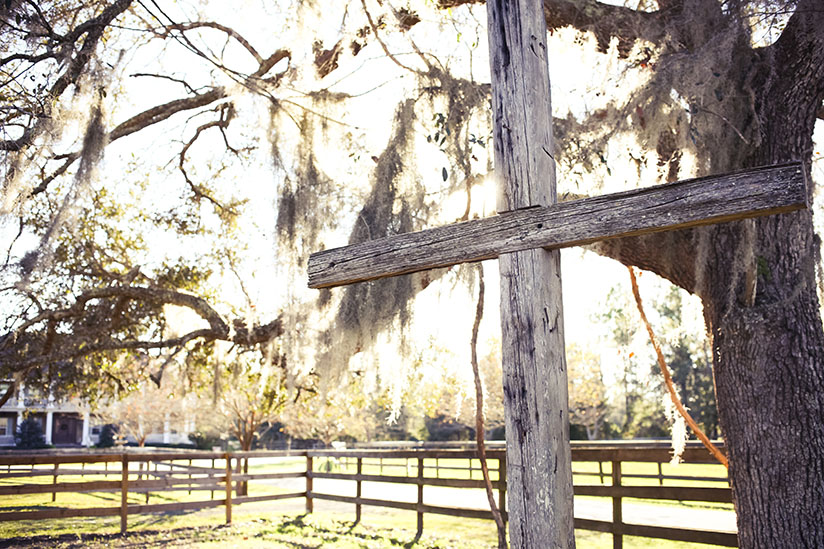 A cross stands vigil at Horse Stamp Inn