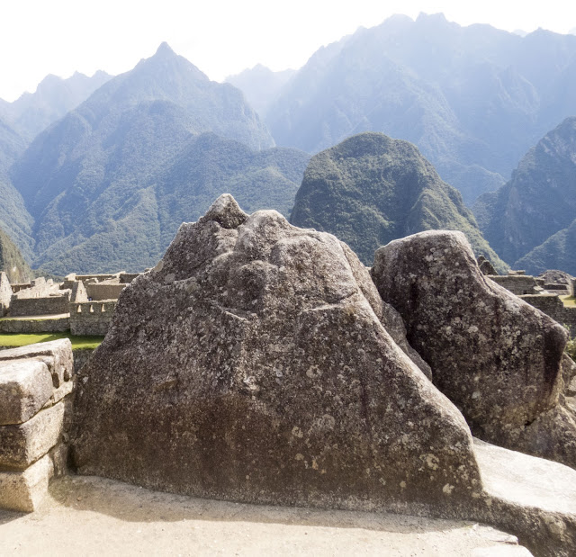 Pics of Machu Picchu: Ceremonial rocks that resemble the Andes in the distance at Machu Picchu