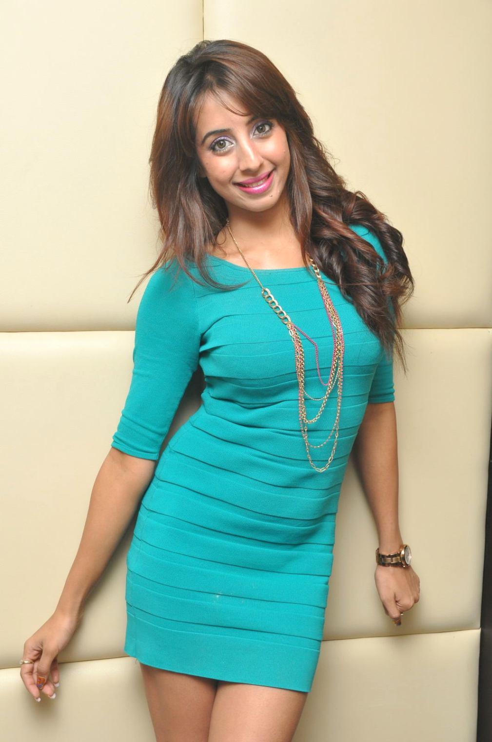 Stylish sanjjana in hot blue dress at tollywood channel press meet