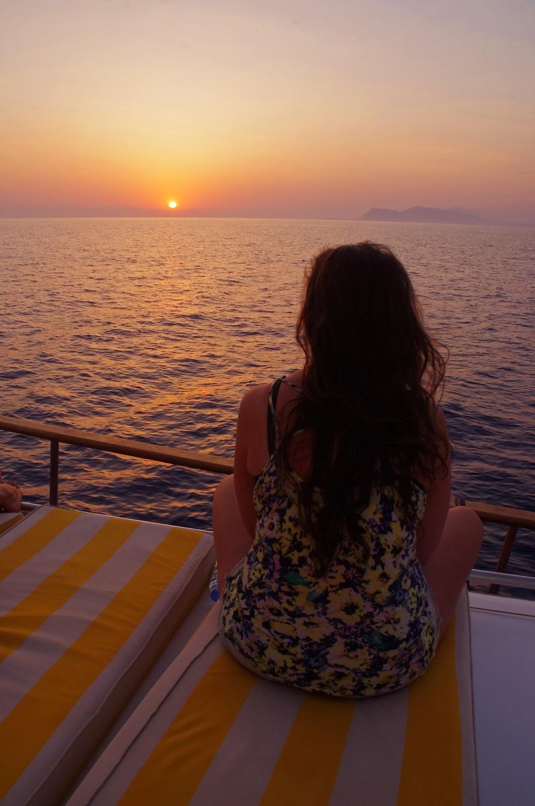 Girl watching sunset sailing in Turkey