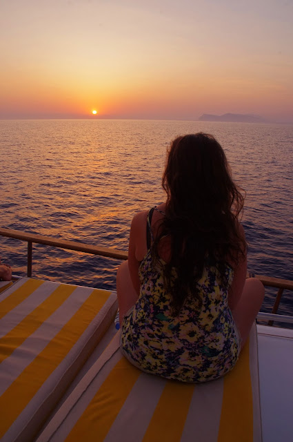 Girl watching sunset sailing in Turkey