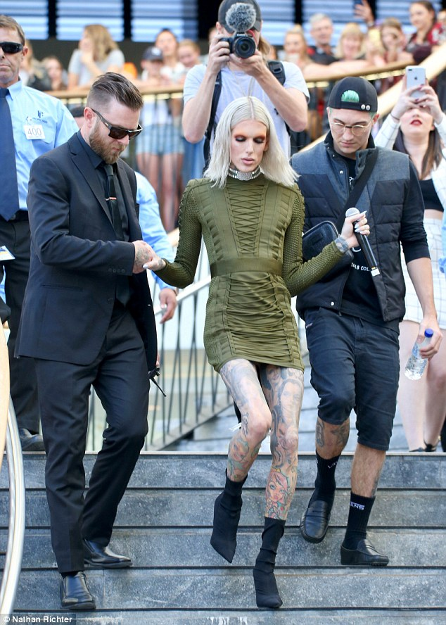 Jeffree Star cuts a chic figure as he is swarmed by hundreds of fans in Queensland