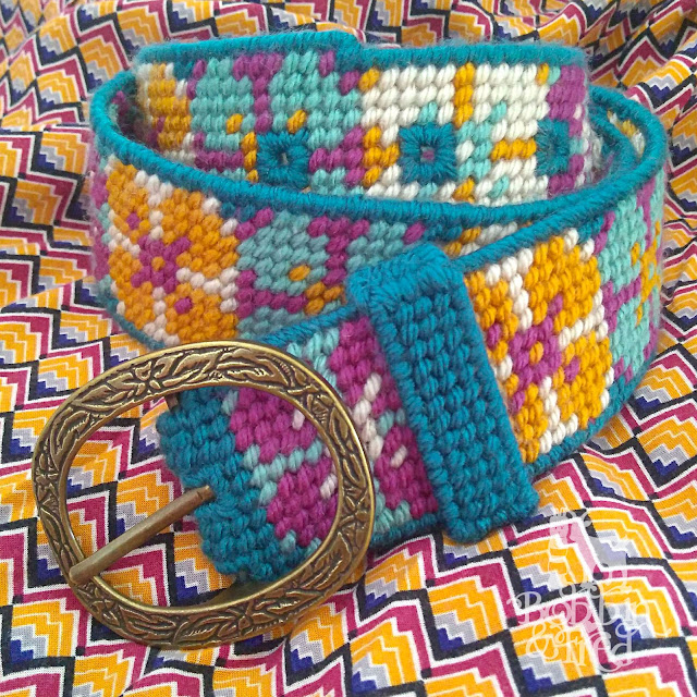 Plastic Canvas Needlepoint Belt with multicoloured floral design, handmade by Bobbin and Fred