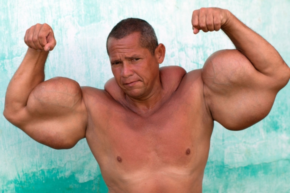 Transcendental macho having a Muscle