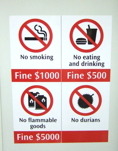 sign with subway rules: no durians; no flammable goods; no smoking; no eating or drinking