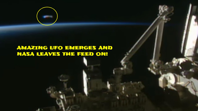 A-huge-UFO-emerges-in-the-background-of-the-International-Space-Station-or-ISS-for-short-and-NASA-employee-and-does-not-realise.