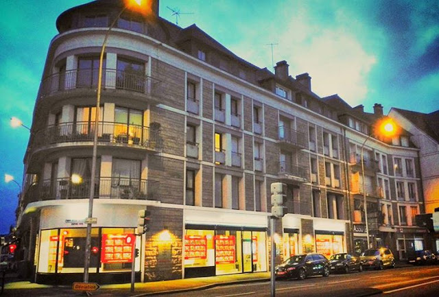 A modern building in quimper night view