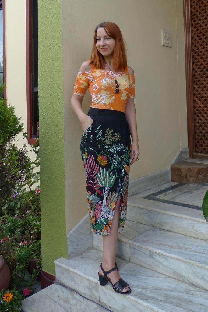Open shoulder top and jungle print pencil skirt