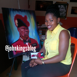 Mary Ogochukwu Nwele infront of her painting of a Knight