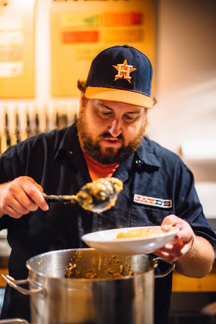Jay Ducote serving up the Sancocho at Red Stick Spice Company