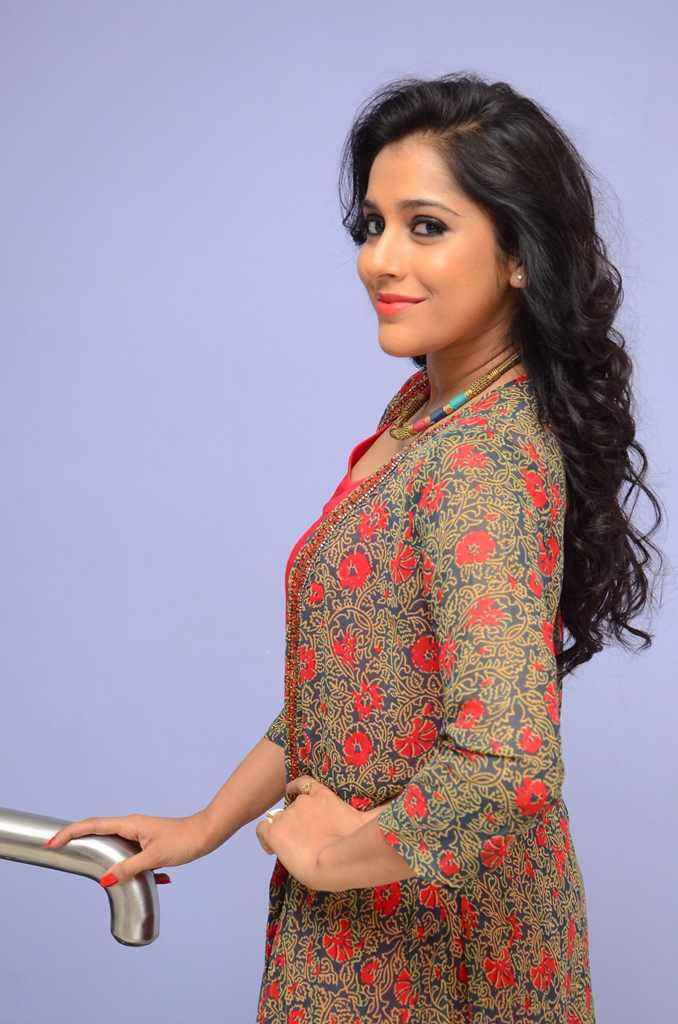 TV Anchor Rashmi Gautam Hot Photos In Red Dress At Movie Song Launch