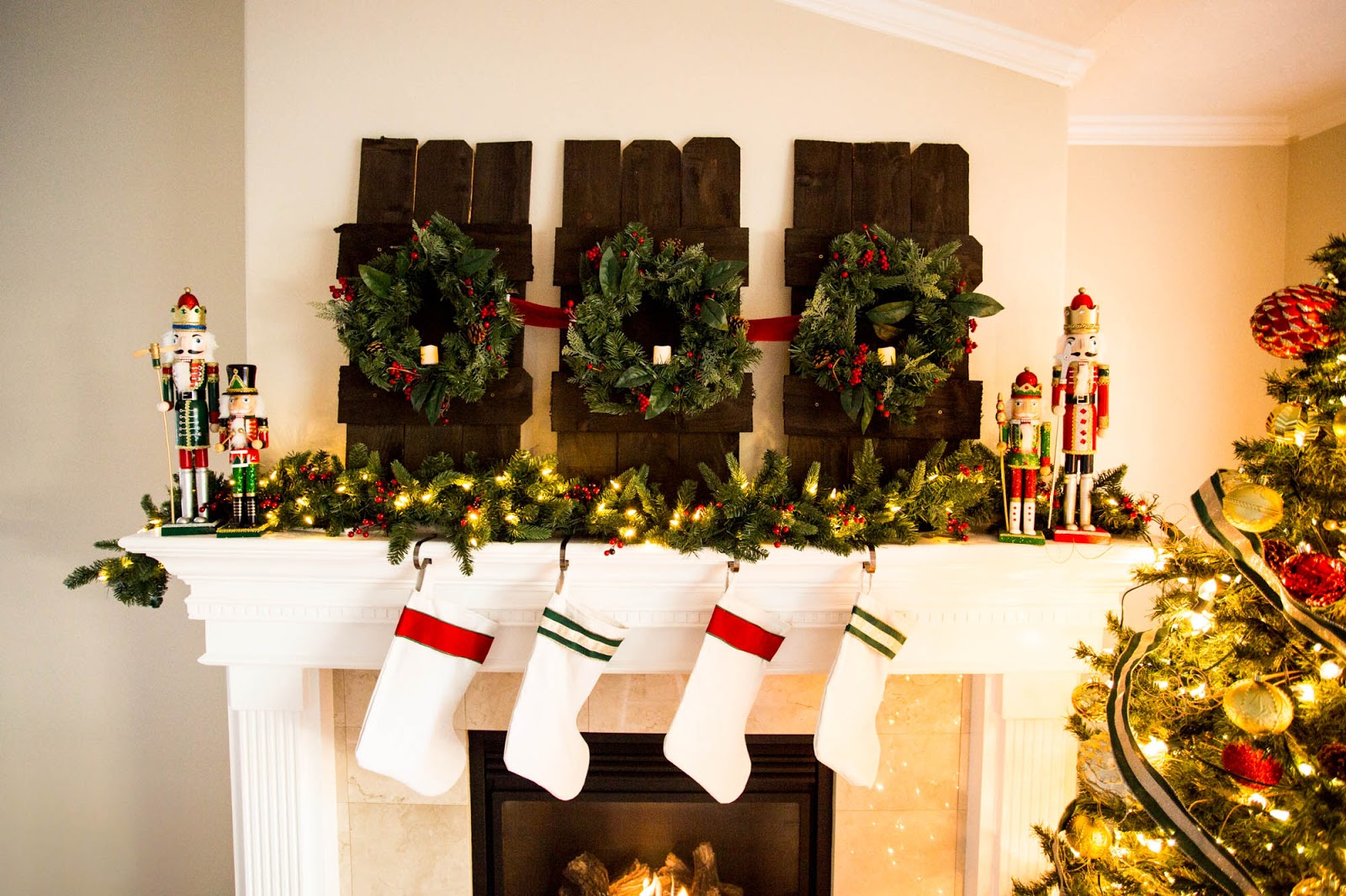 Do it yourself divas decorating a mantle for christmas with home diy christmas mantle fireplace nutcrackers garland lights candles solutioingenieria Choice Image