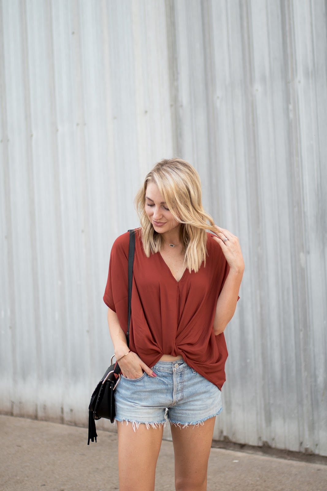 twist-front blouse with casual cutoffs