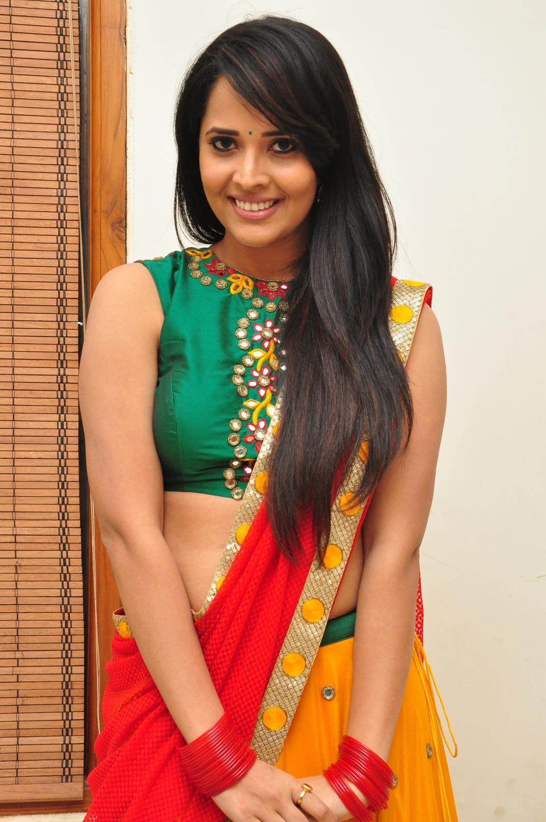 TV Anchor Anasuya In Red Dress At Telugu Film Audio Launch