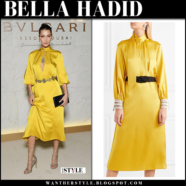 Bella Hadid in yellow satin midi dress fendi party holiday style december 5