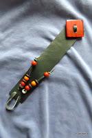 LoveLea's dark green leather bracelet with red vintage button.