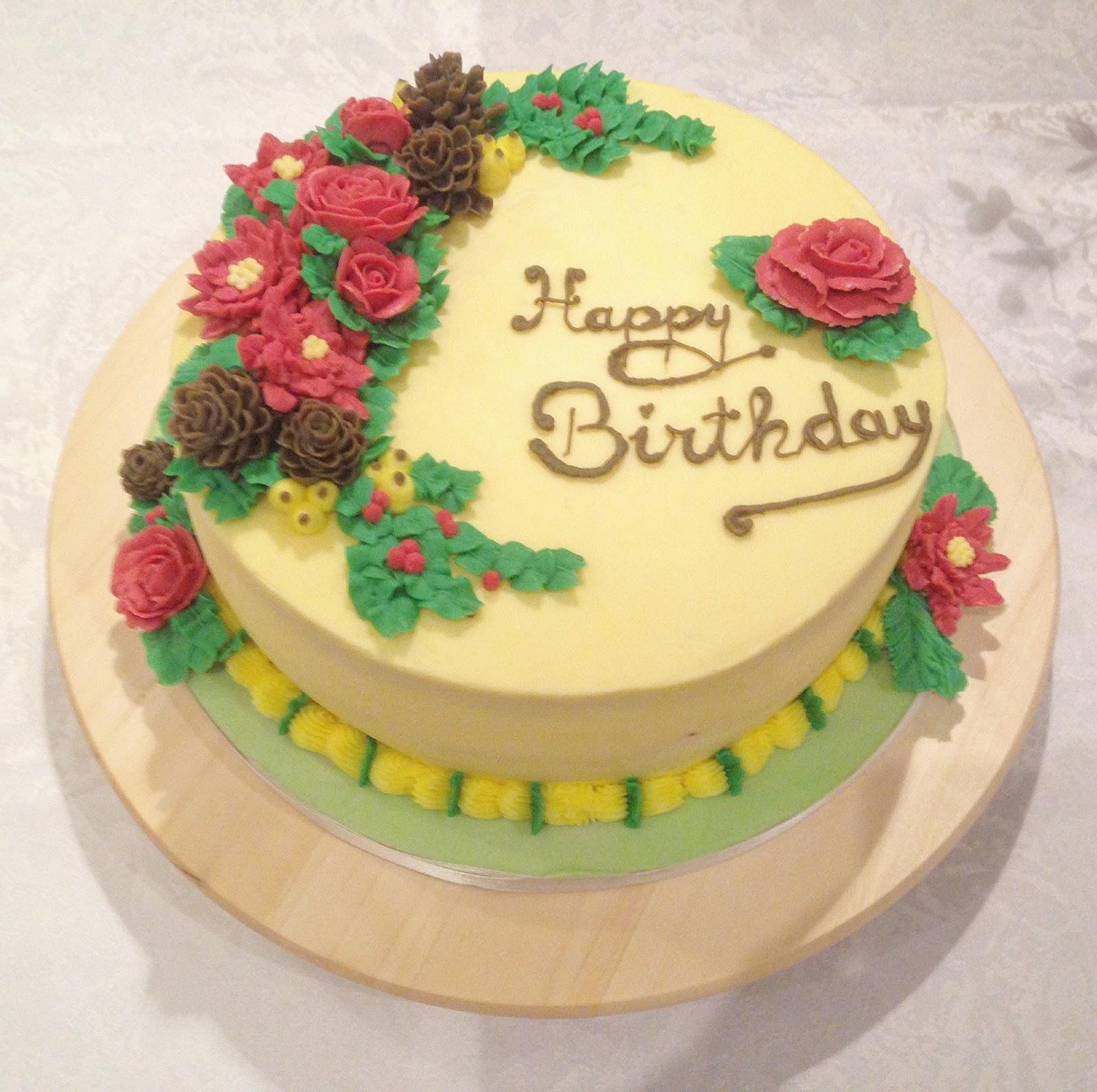 Adventstorte mit Blumen aus Buttercreme: Poinsettia, Rose, Tannenzapfen, Blattwerk - mit Videotutorial