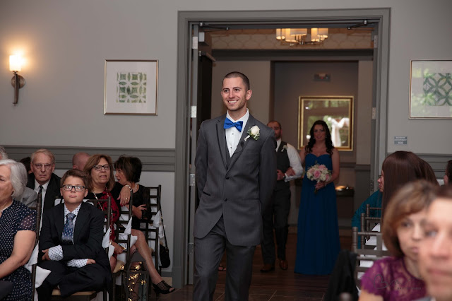 groom walking in at Noah's Event Venue in Auburn Hills Michigan