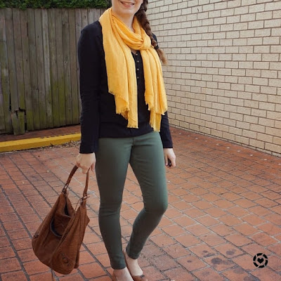 awayfromtheblue instagram jeanswest mustard scarf black blouse olive skinny jeans balenciaga day bag