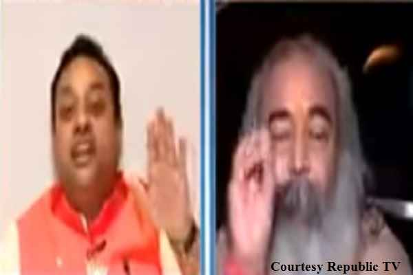 warm-debate-with-sambit-patra-and-acharya-pramaod-krishnam