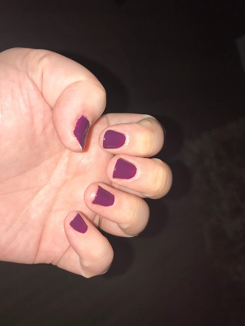 painted purple finger nails