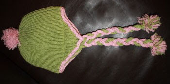 Green/pink variation of the free earflap hat knitting pattern.