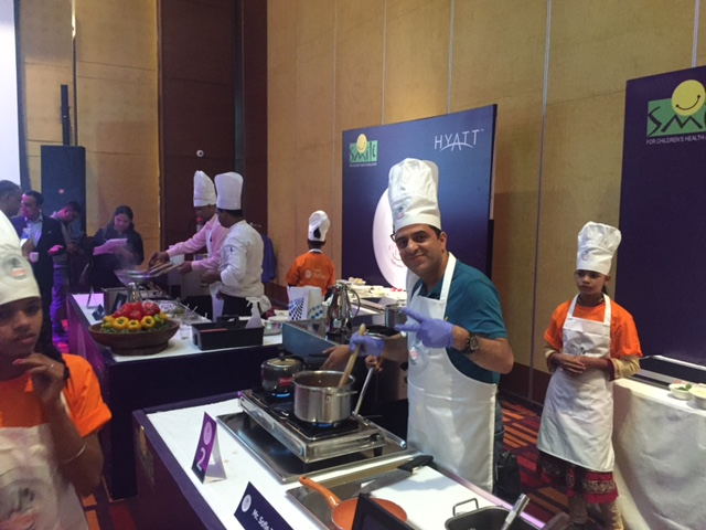 Mr. Sofie Zahoor Director, Quark Express prepaing his dish 'Mutton Rogan Josh'