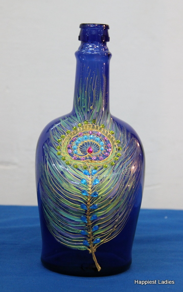 peacock feather painting on glass bottle
