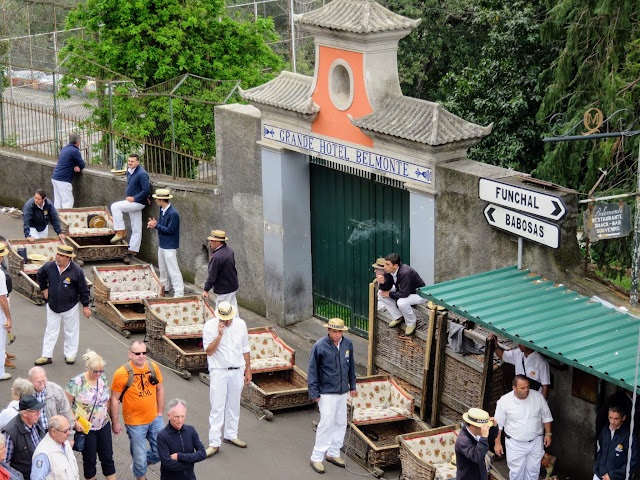 Toboggan drivers waiting for passengers in Monte, Madeira