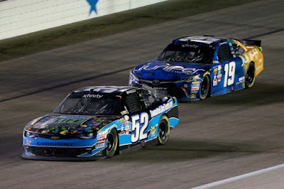 Joey Gase, driver of the #52 Donate Life Texas Chevrolet, leads Daniel Suarez, during the NASCAR XFINITY Series O'Reilly Auto Parts 300 at Texas Motor Speedway on April 8, 2016 in Fort Worth, Texas.