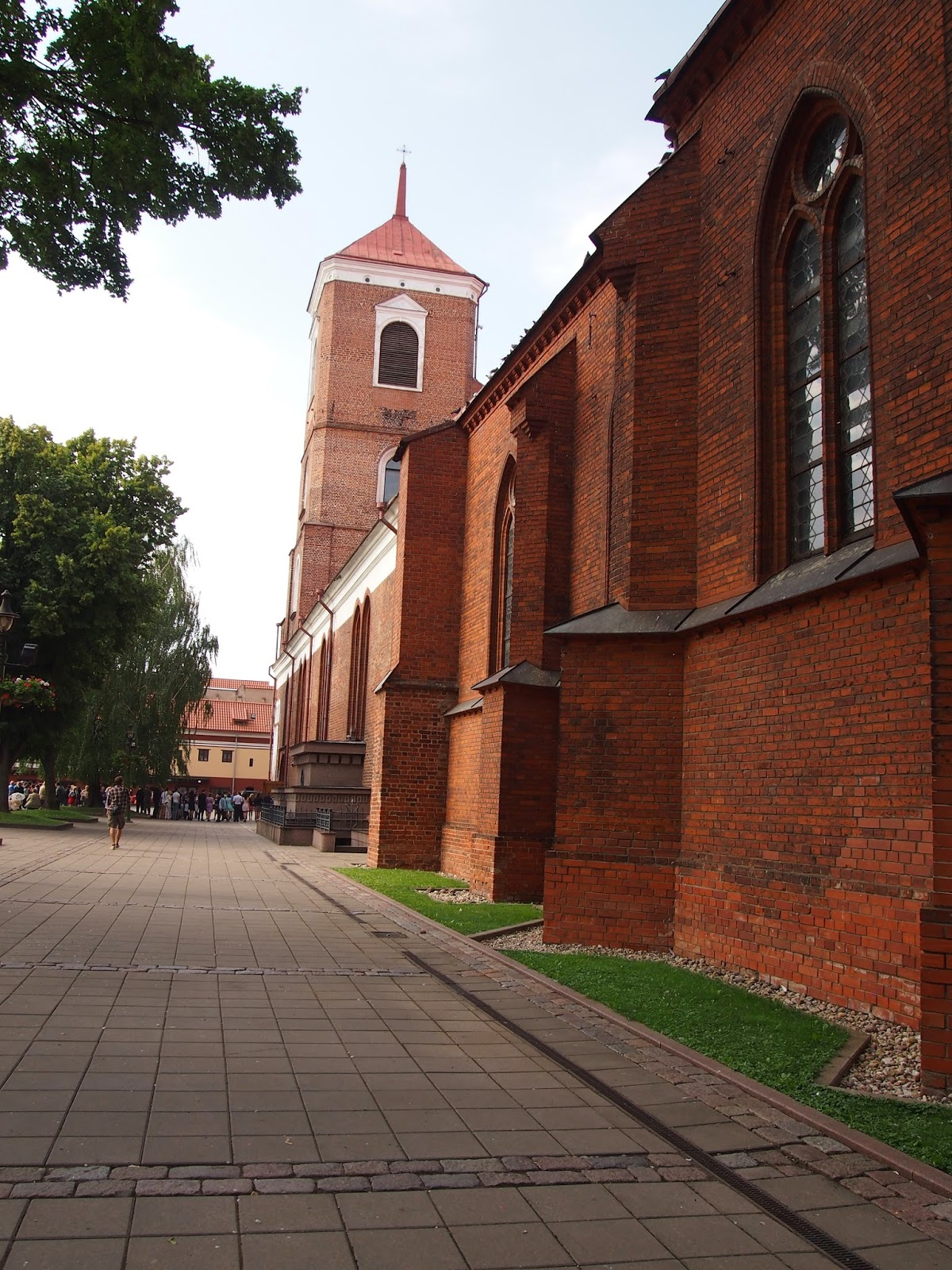 the large brick exterior of the Cathedral of Sts. Peter and Paul in Kaunas Old Town