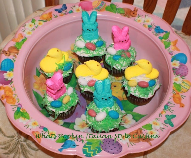these are cupcakes with a variety of marshmallow peeps on the for Easter