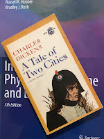 A Tale of Two Cities, by Charles Dickens, superimposed on Intermediate Physics for Medicine and BIology.