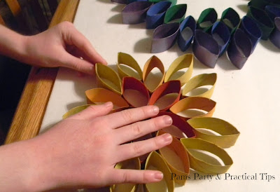 Gluing together the hanging rainbow flower