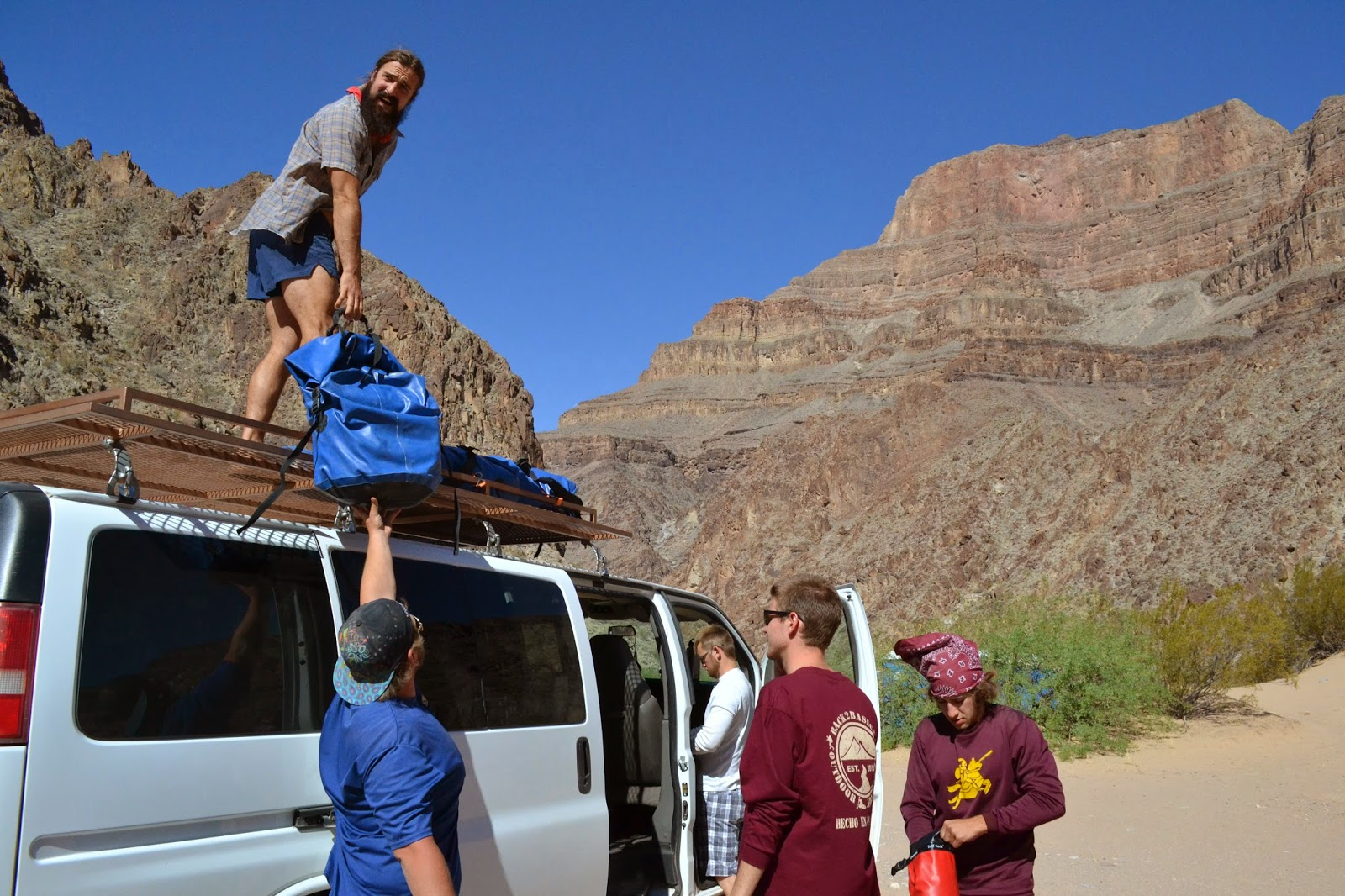 standing on van in grand canyon