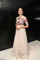 Ritu Varma smiling face Cream Anarkali dress at launch of OPPO New Selfie Camera F3 ~  Exclusive 001.JPG