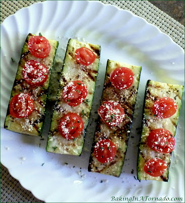 Italian Style Grilled Zucchini proves that grilling isn't just for the main dish. This flavorful side dish comes together in minutes. | Recipe developed by www.BakingInATornado.com | #recipe #vegetable