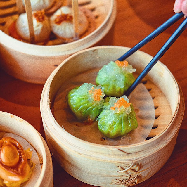 Steamed Shrimp Dumplings topped with Bird's Nest and Tobiko