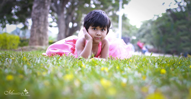 a cute little girl posing captured by mamatha photography